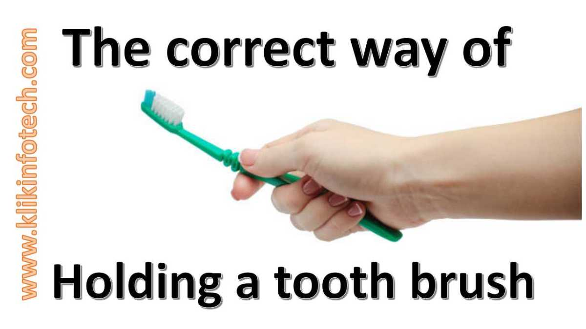 The correct way of holding a Tooth Brush